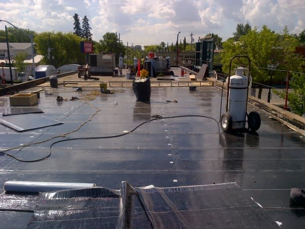 3 New SBS roof being installed